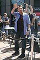 ryan seacrest standing on top of box 04