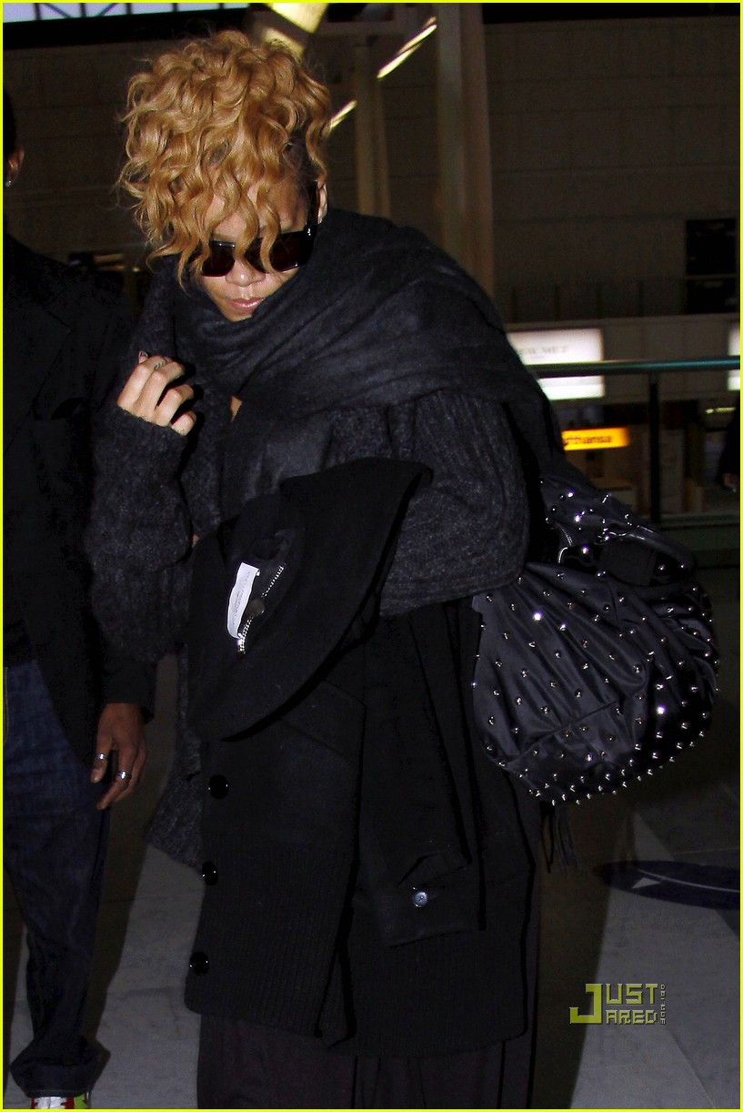 rihanna departs nice airport after nrj awards 062411117