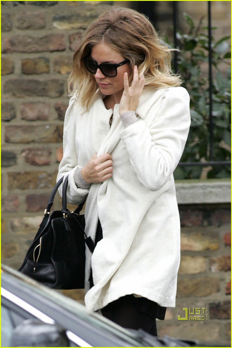sienna miller leaves jude law house 07
