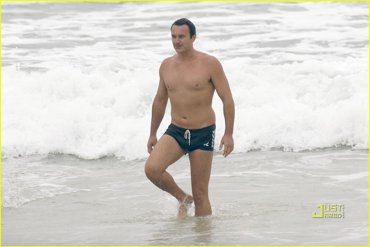 julian mcmahon beach tiny swim trunks 05