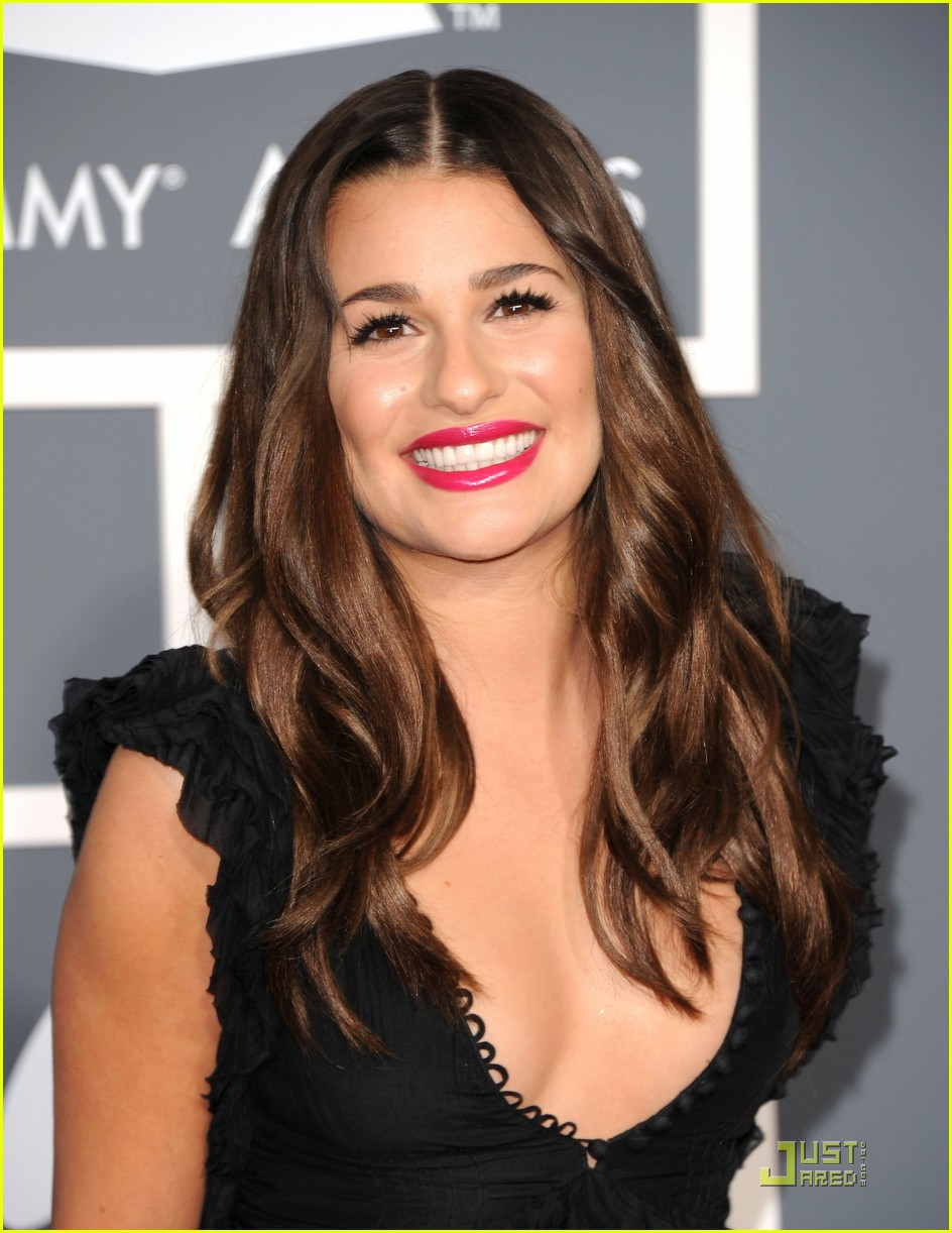 Lea Michael wearing a dark brown hair color with a cool skin tone