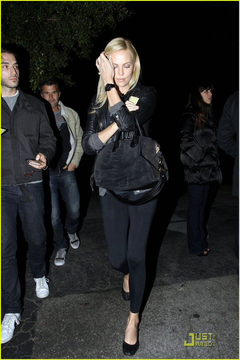 charlize theron dines with a mystery male 072524480