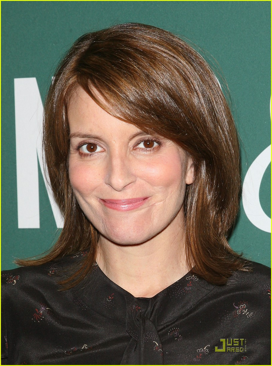 Tina Fey proudly shows off her new book,