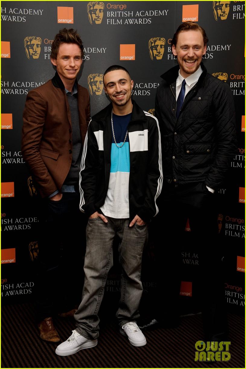 tom hiddleston eddie redmayne bafta orange 07
