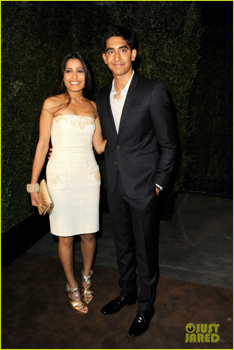 freida pinto dev patel chanel pre oscar party pair 05