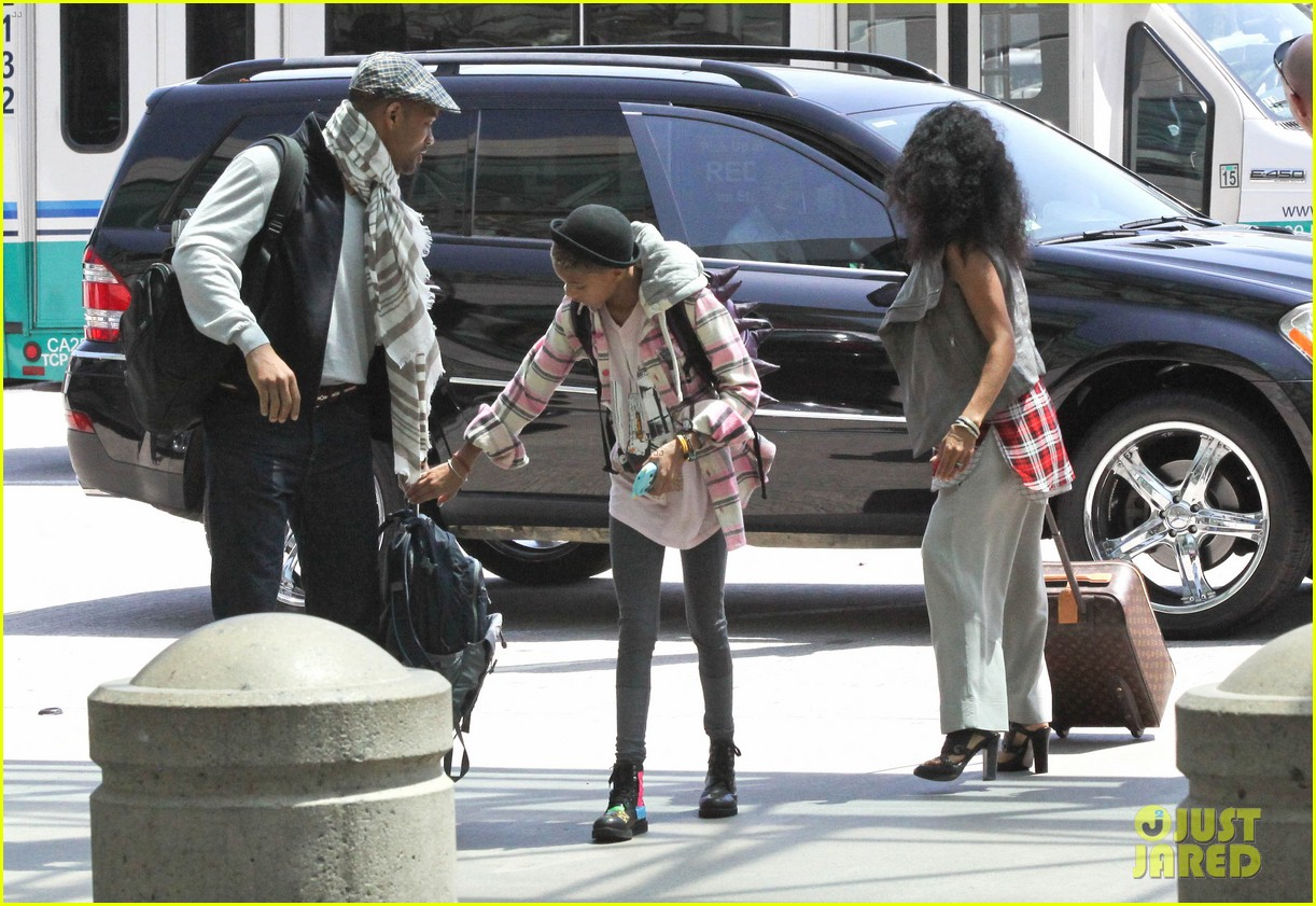 willow smith catches flight at lax with mom dad 11