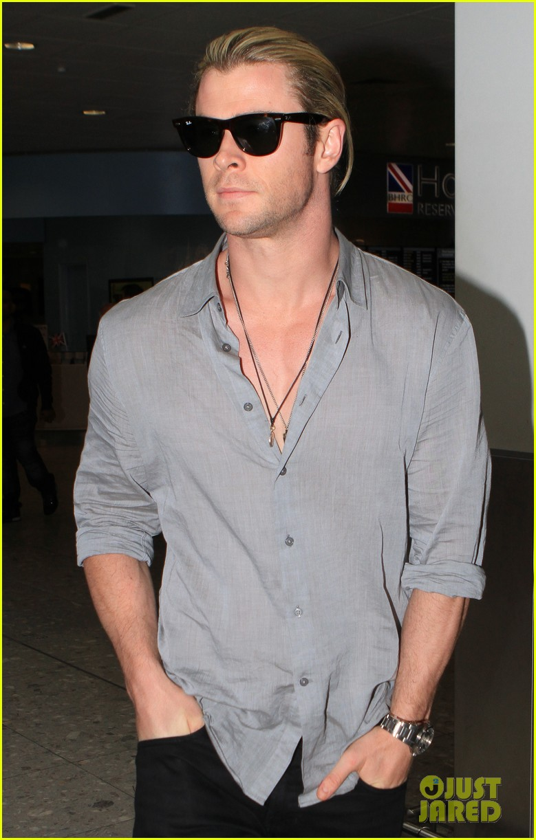 chris hemsworth landing in london 07