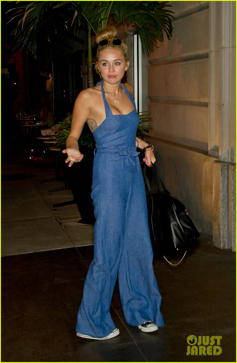 miley cyrus denim jumpsuit with liam hemsworth 01
