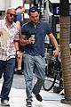 leonardo dicaprio hides under umbrella on wolf set 07