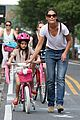 katie holmes teaches suri cruise to ride a bike 01