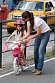 katie holmes teaches suri cruise to ride a bike 05