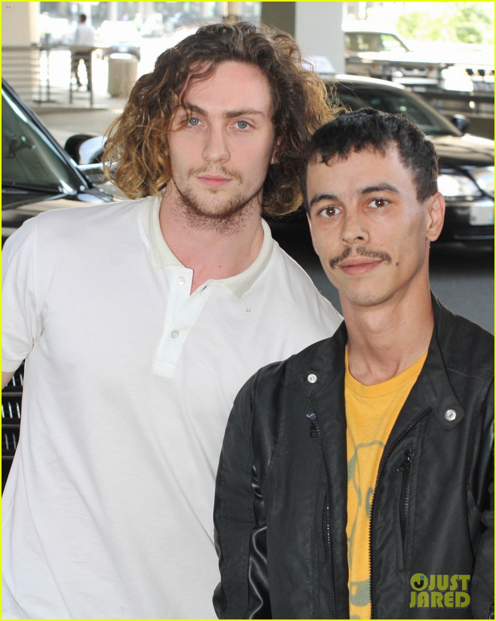 aaron taylor johnson airport with sam wylda rae romy hero 082714896