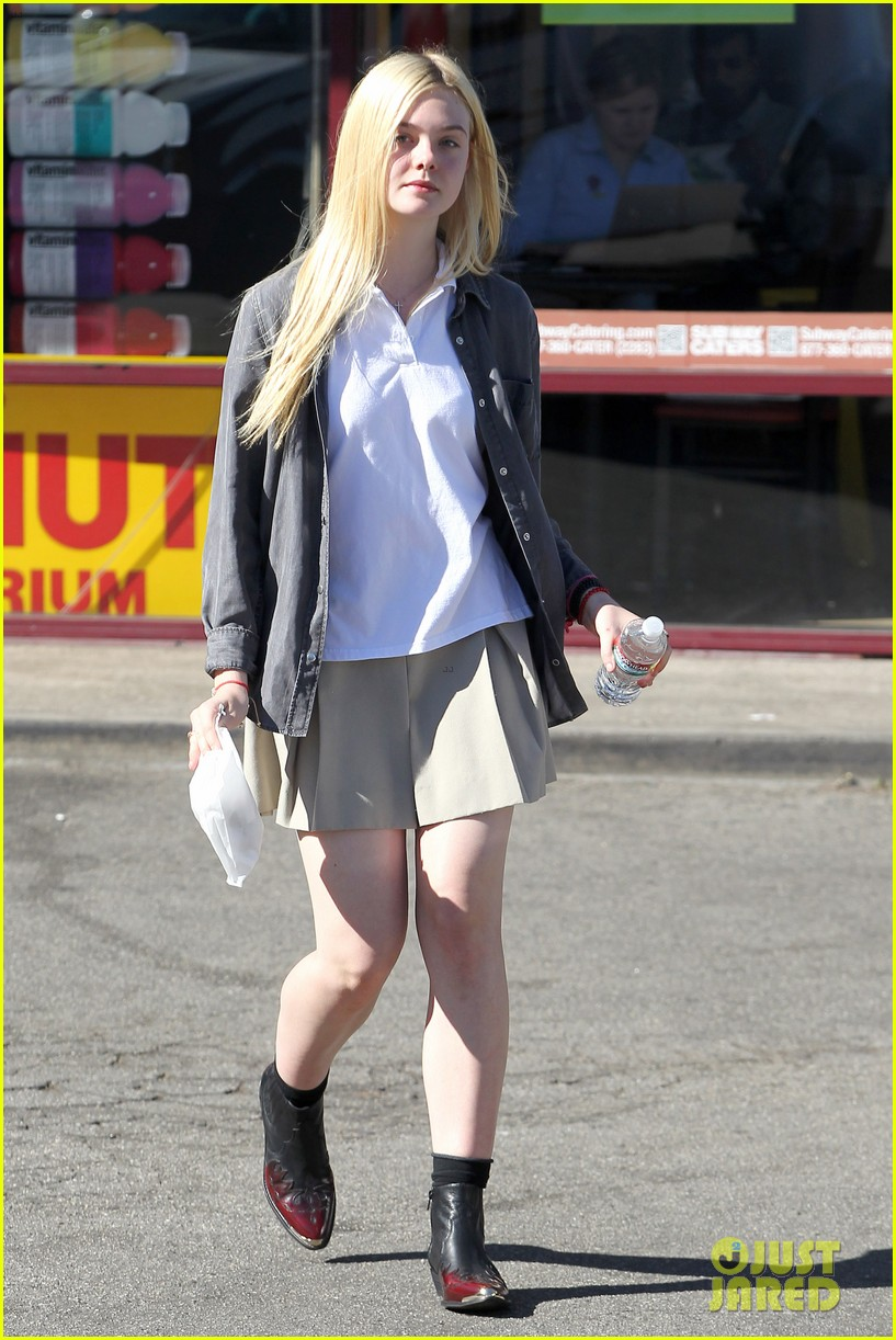 elle fanning showing some leg 13