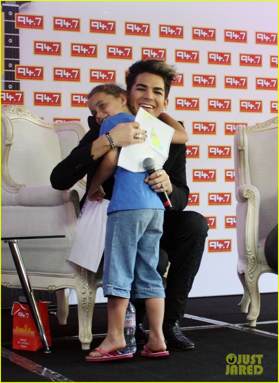 adam lambert hugs lucky young fan in south africa 042759978