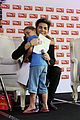 adam lambert hugs lucky young fan in south africa 04