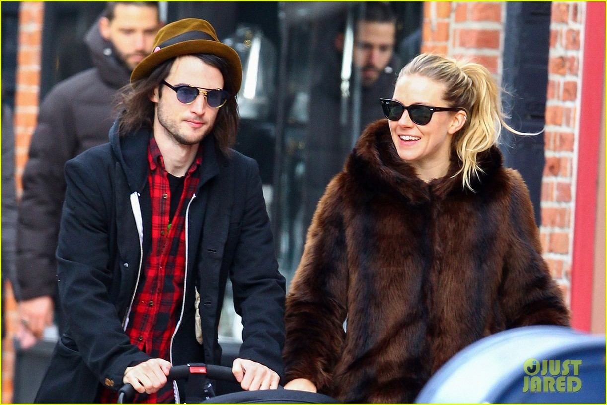 sienna miller tom sturridge sunday stroll with baby marlowe 02