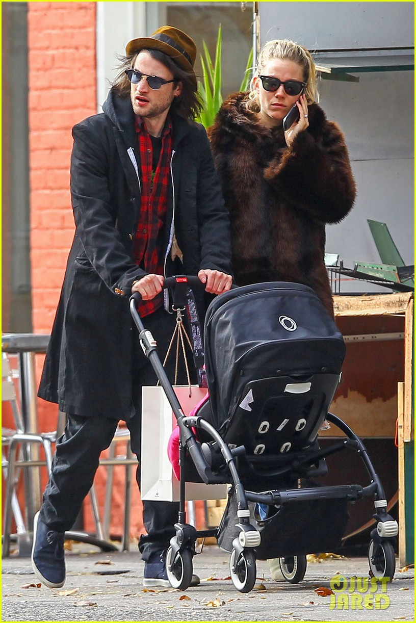 sienna miller tom sturridge sunday stroll with baby marlowe 05