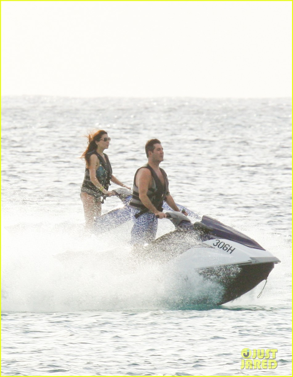 simon cowell jet skiing with former fiancee mezhgan hussainy 06