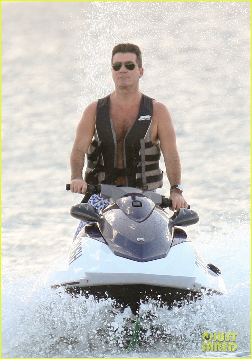 simon cowell jet skiing with former fiancee mezhgan hussainy 10