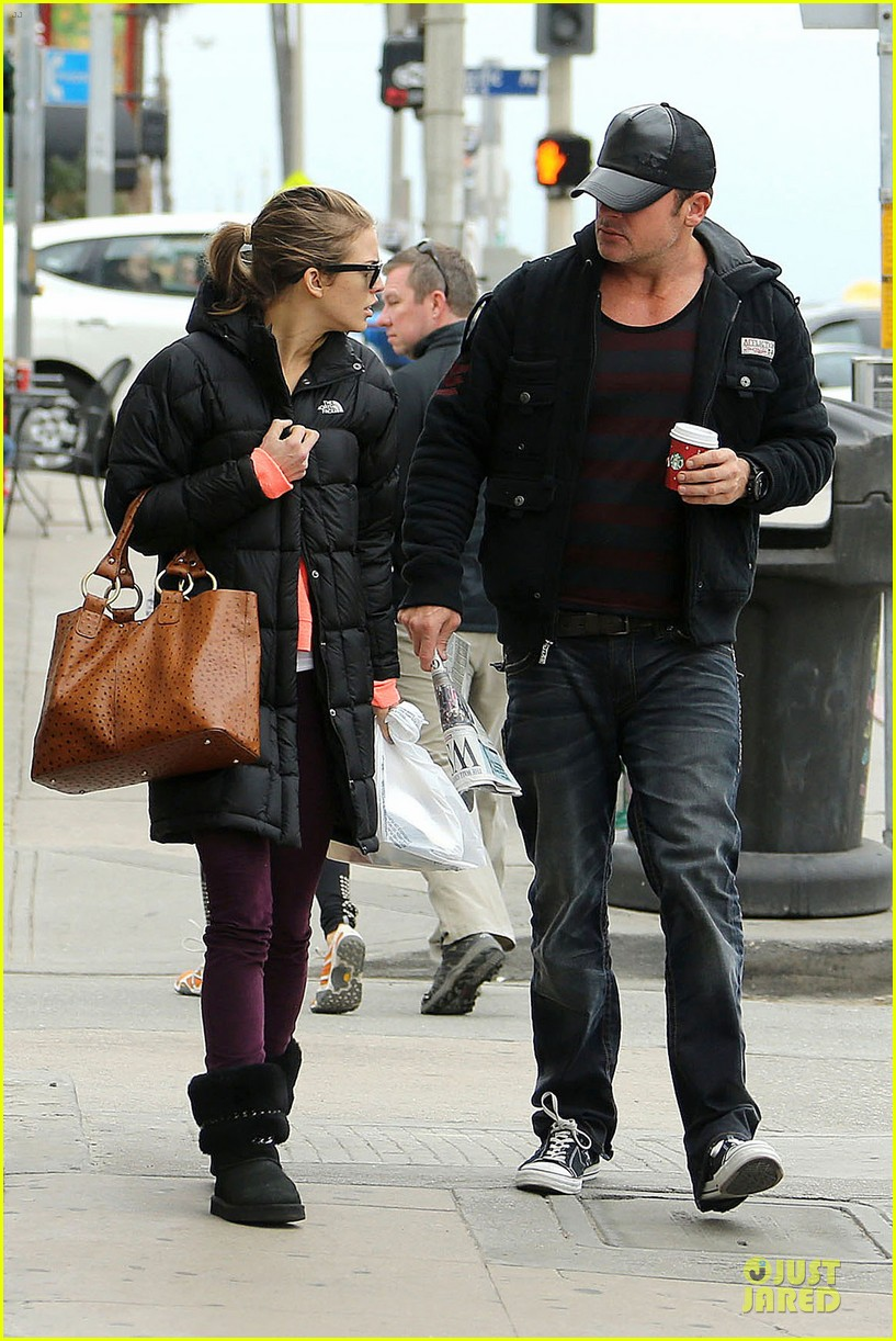 annalynne mccord & dominic purcell coffee strolling couple 032777154