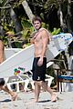 chris liam hemsworth shirtless surfing duo 06