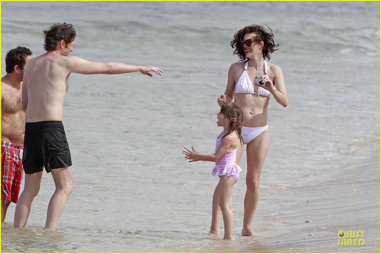 milla jovovich new years bikini outing 03
