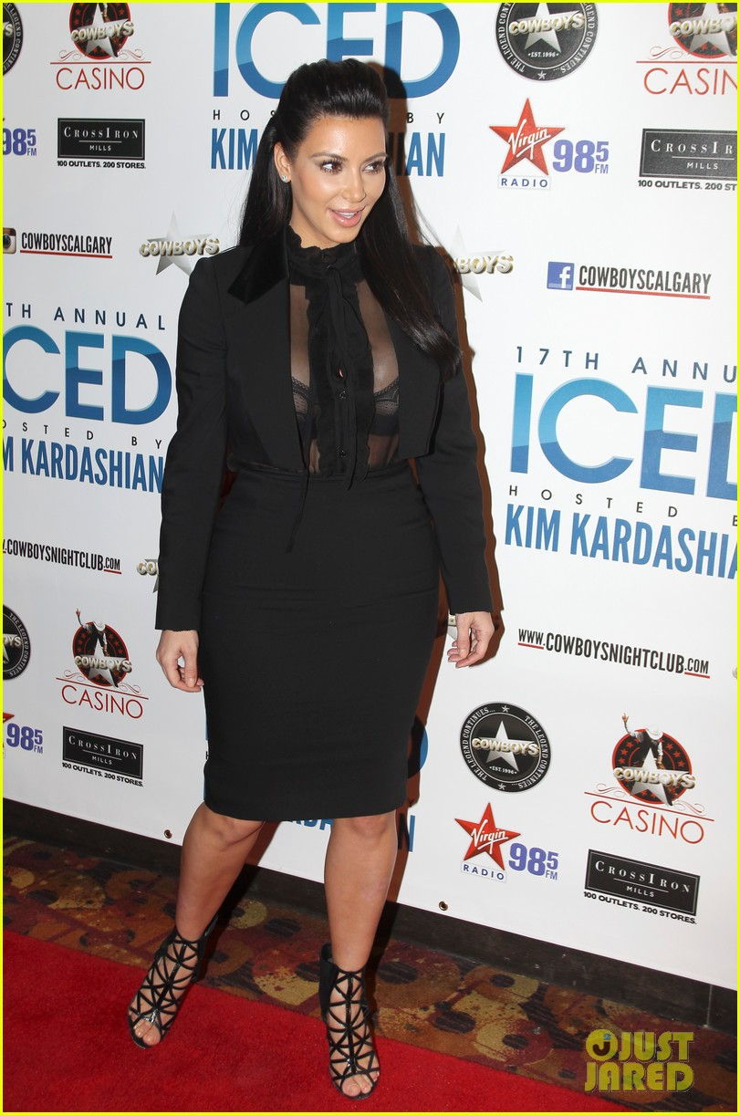 pregnant kim kardashian sheer top at iced event 01