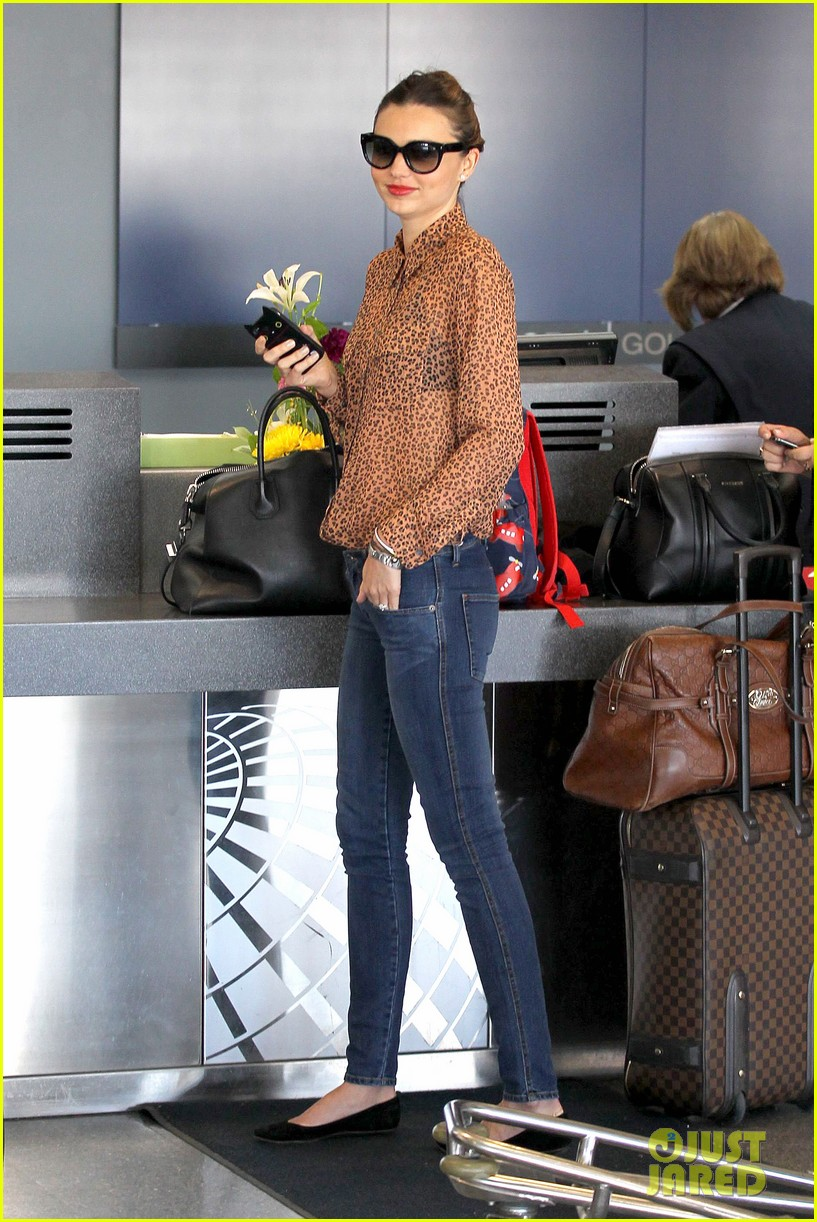 miranda kerr orlando bloom flynn family flight 06