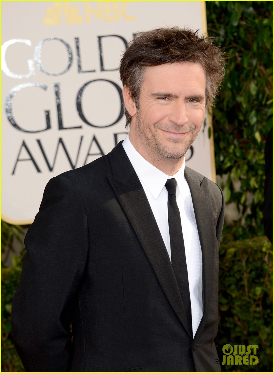 debra messing jack davenport golden globes 2013 red carpet 072790840