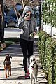 miley cyrus hoodie walk with pet pooch 07