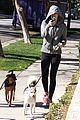 miley cyrus hoodie walk with pet pooch 10