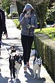 miley cyrus hoodie walk with pet pooch 12
