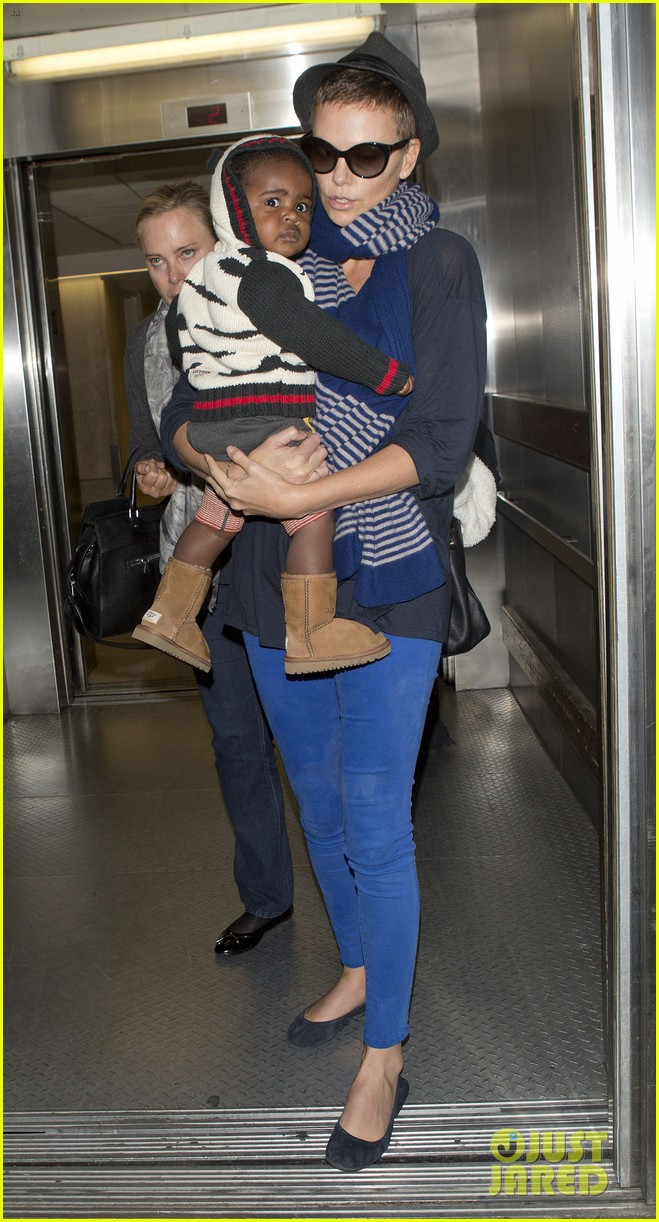 charlize theron lax arrival with jackson 022786100