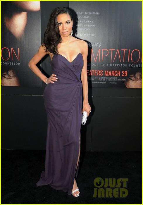 kim kardashian holds baby bump at temptation premiere 03
