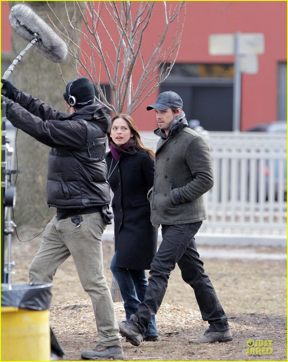 kristin kreuk gun carrying beauty and the beast scene 01
