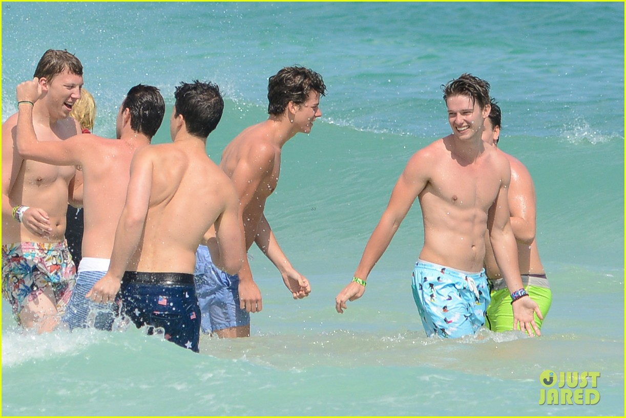 patrick schwarzenegger shirtless beach football 112837561