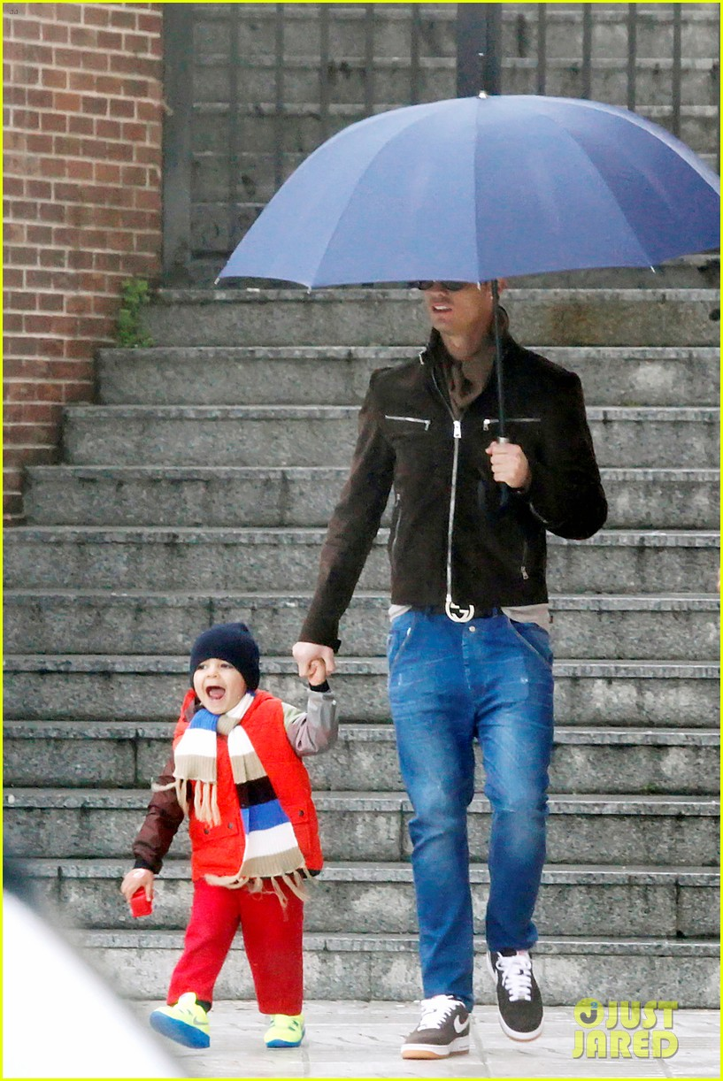 cristiano ronaldo rainy madrid day with cristiano jr 02