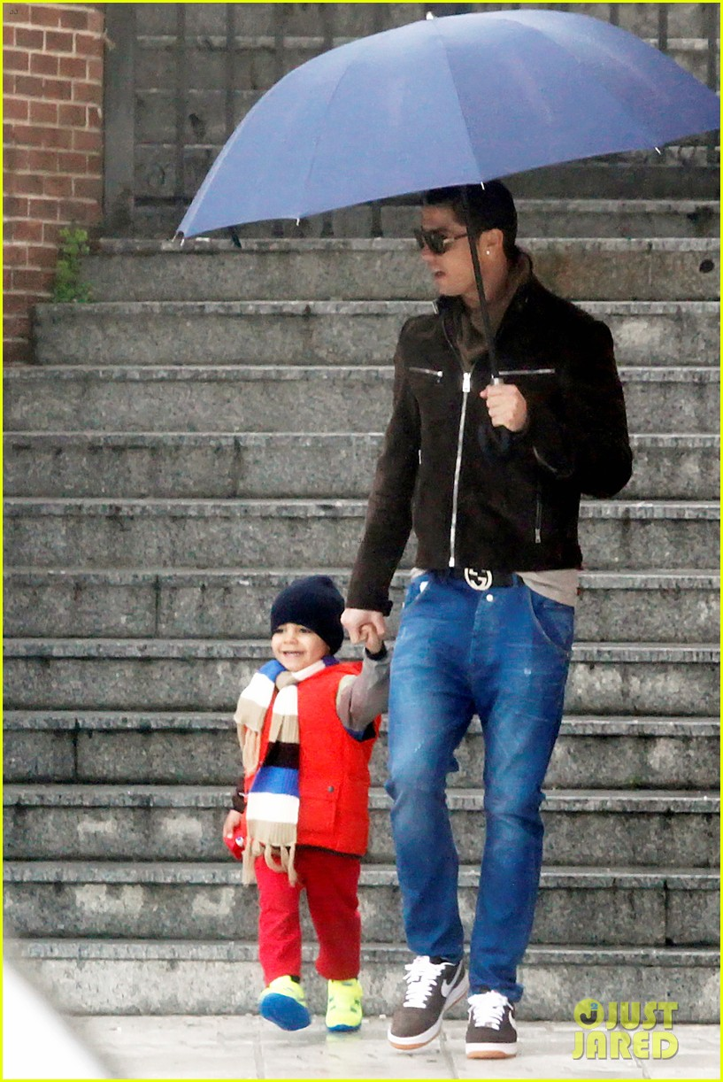 cristiano ronaldo rainy madrid day with cristiano jr 11