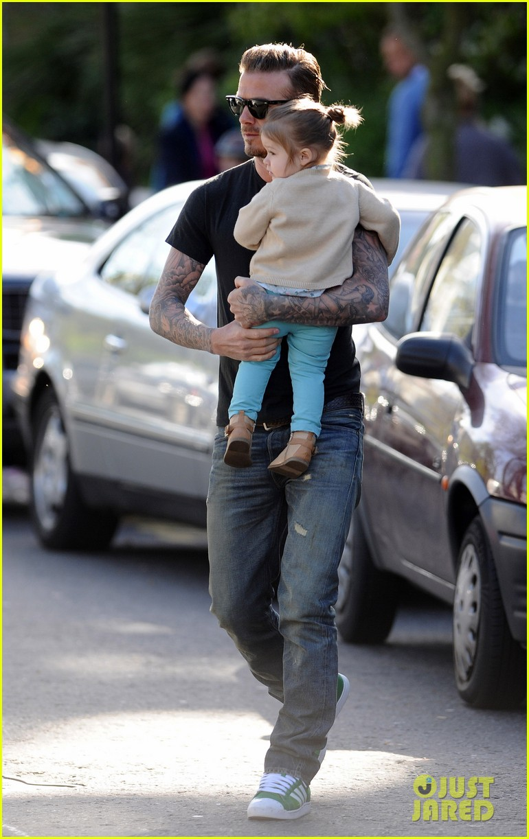 david beckham holds harper close 01