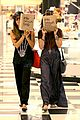 vanessa hudgens ashley tisdale hide behind their bags 03
