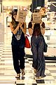 vanessa hudgens ashley tisdale hide behind their bags 12