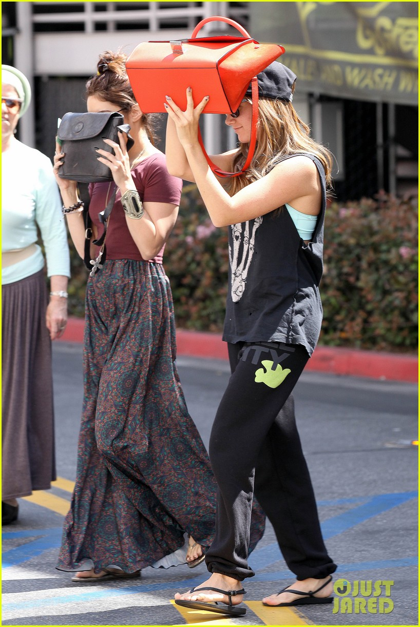 vanessa hudgens ashley tisdale hide behind their bags 212842954