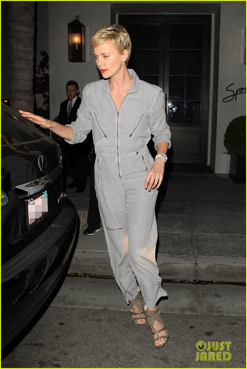 charlize theron rocks jumpsuit for dinner with jackson 05