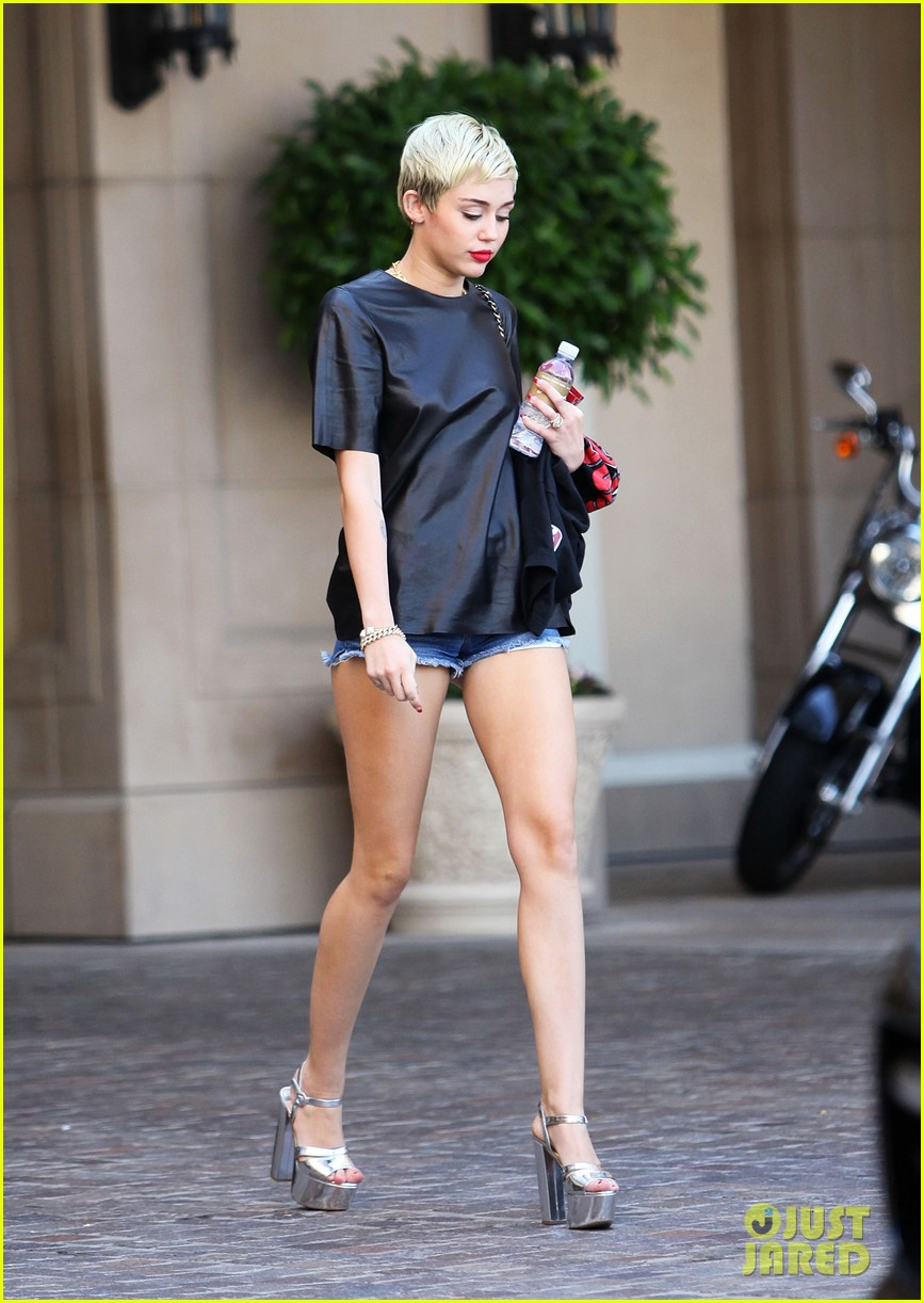 miley cyrus liam hemsworth separate cali outings 032856371