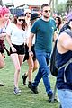kristen stewart robert pattinson holding hands at coachella day two 12