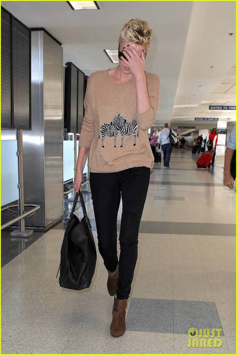 charlize theron zebra sweater at the airport 102852153