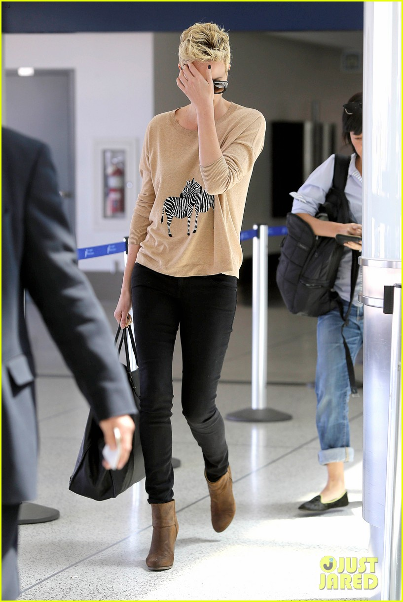 charlize theron zebra sweater at the airport 18