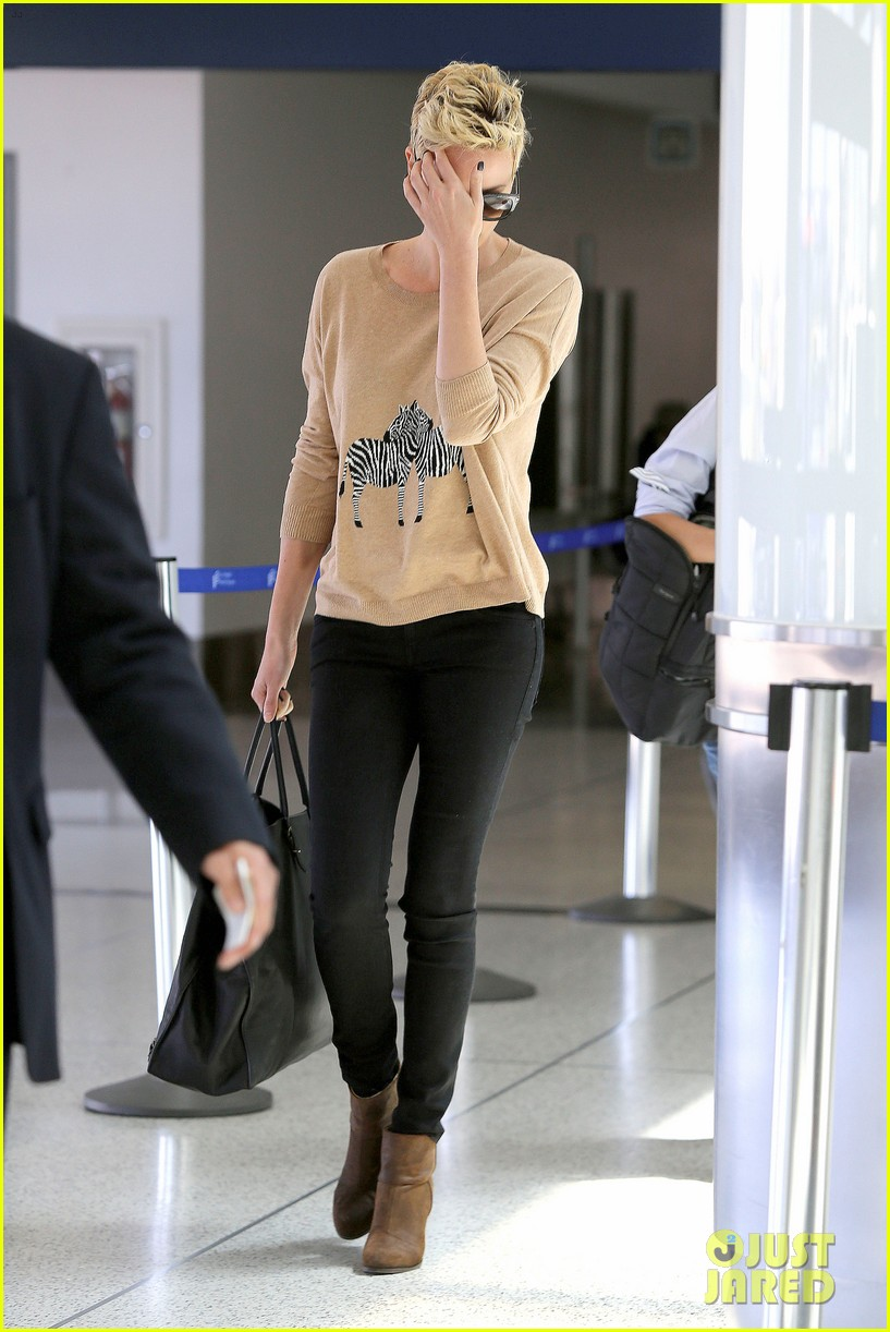 charlize theron zebra sweater at the airport 19