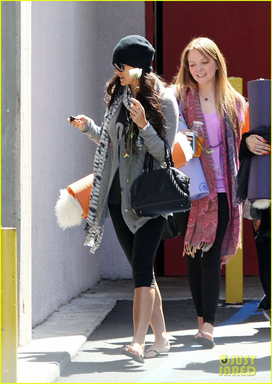 demi lovato carries a white rose out of yoga class 01