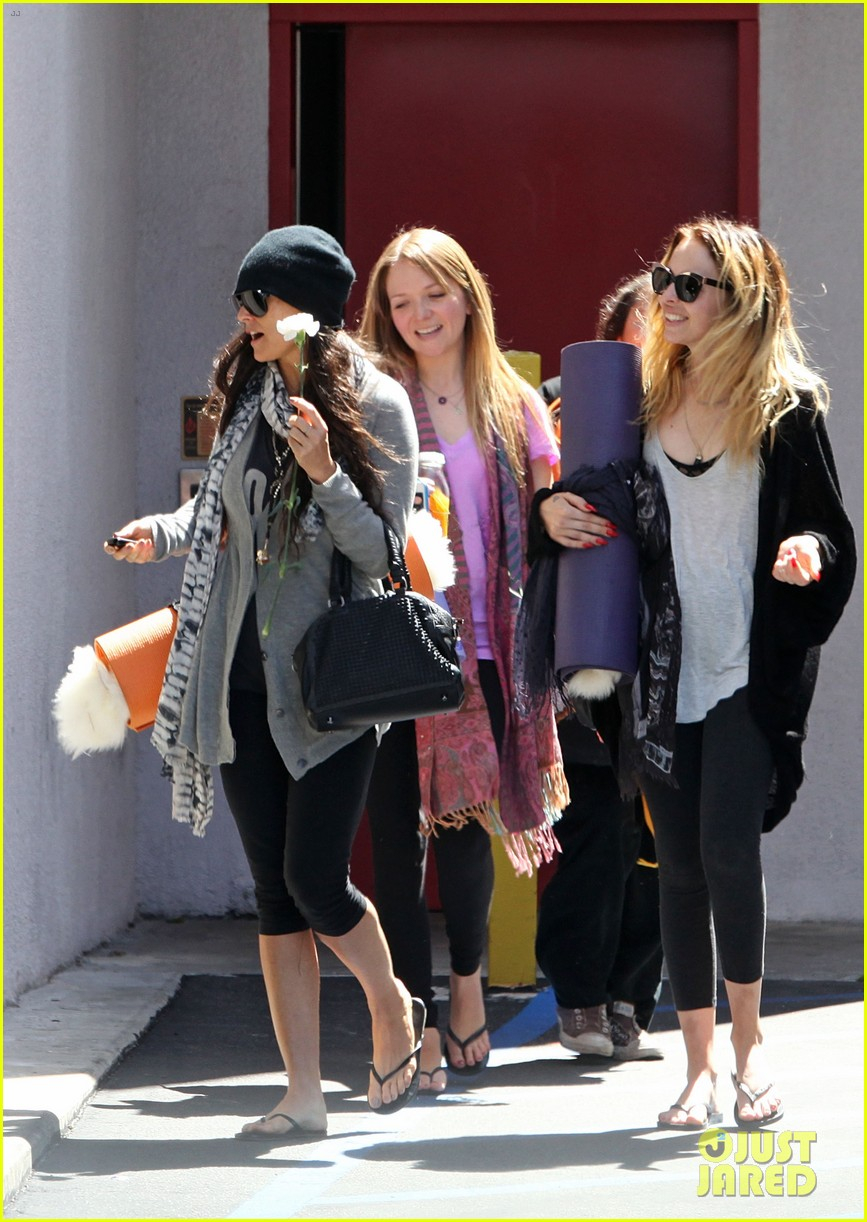 demi lovato carries a white rose out of yoga class 082868995